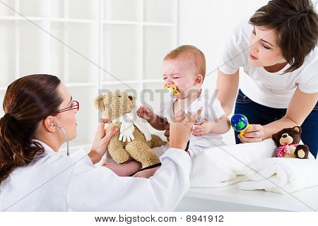 nurse checking crying baby