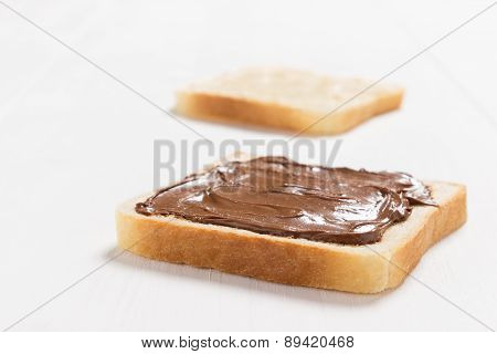 Two slices of bread with chocolate hazelnut spread