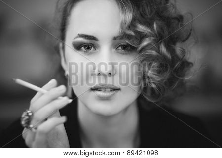 girl model with a cigarette looks straight