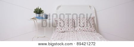 White Bed With Floral Bedding