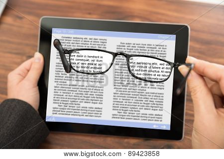 Person Reading E-book With Spectacles