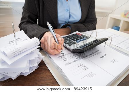 Businessperson Calculating Bills