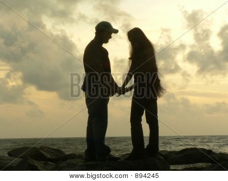 Couple At The Beach In The Evening