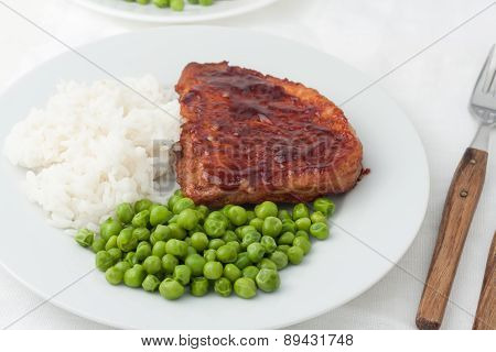 Juicy Cooked Steaks With Green Peas