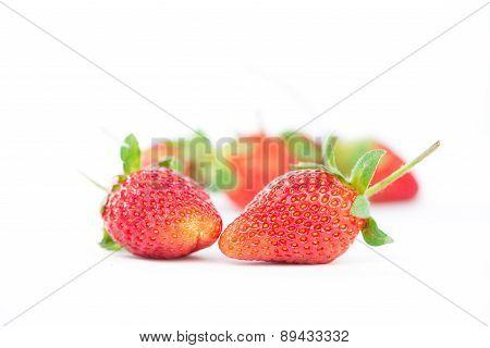 Strawberries In Plastic Box On White
