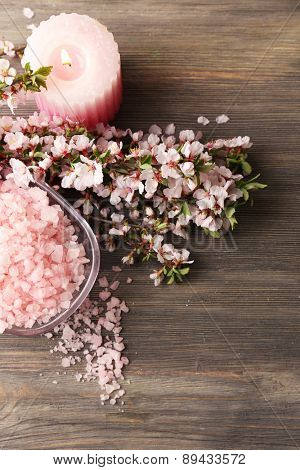 Spa still life with flowering branches on wooden table, top view