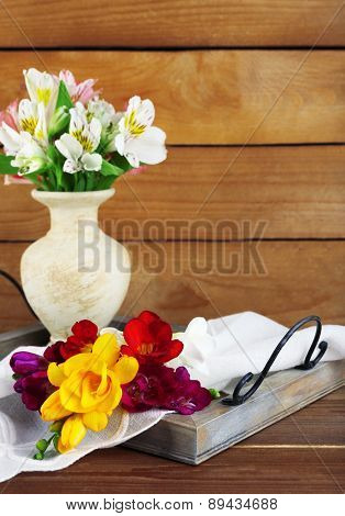 Beautiful spring flowers on wooden background