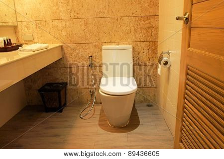 Closed Up Bathroom In Yellow Light