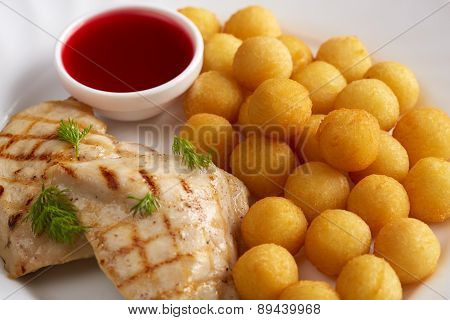 Grilled meat, cheese balls and cranberry sauce