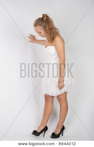 A Young Girl In A White Dress