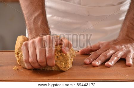 Cook preparing dough for cookies.Hands kneading dough.