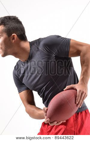 Rugby player on white background.holding a rugby ball.
