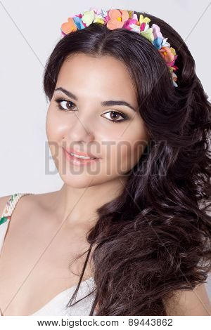 delicate elegant beautiful schaslivo smiling woman with long black hair curls with a colored rim