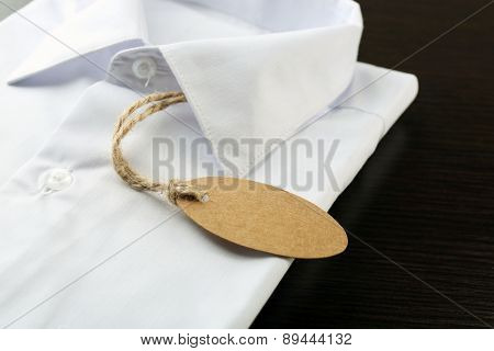 Price tag on white shirt, close-up
