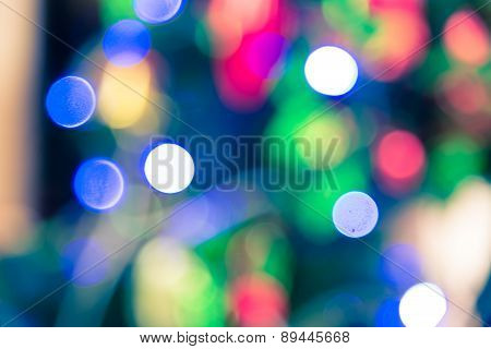 Bokeh Blur Of Light Decoration On  Christmas Tree