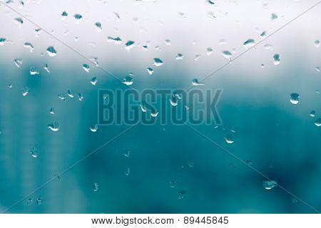 Mirror With Rain Drop In Building  In Split Tone Background