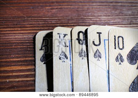 Playing cards on wooden table, closeup