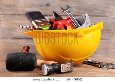 Construction tools in helmet on table close up