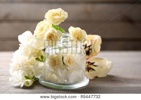 Beautiful composition with flowers on grey wooden  background