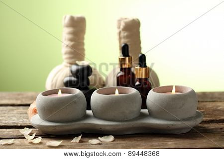 Beautiful spa composition on wooden table, on green background