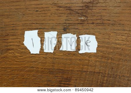 Torn Letters Against Wood Background