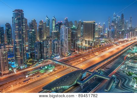 A skyline panoramic view of Dubai Marina showing the Marina and Jumeirah Beach Residence.