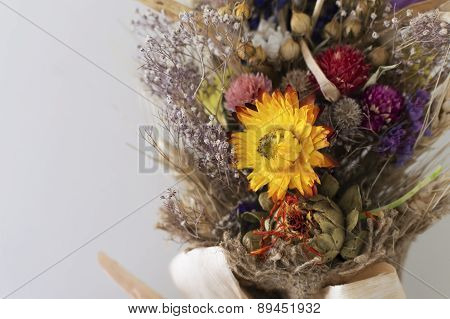 Bunch Of Dried Flowers Over Gray Background