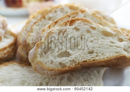 Close Up Of Hunches Of White Bread Lying On Table