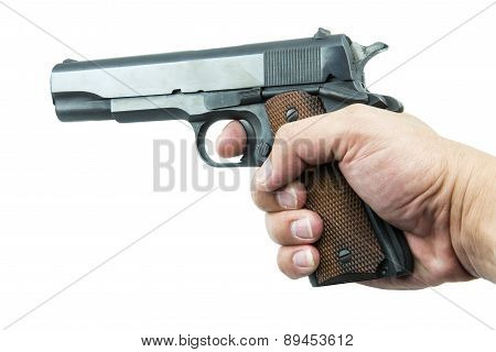 11 mm. Black gun in hand isolated a white background.