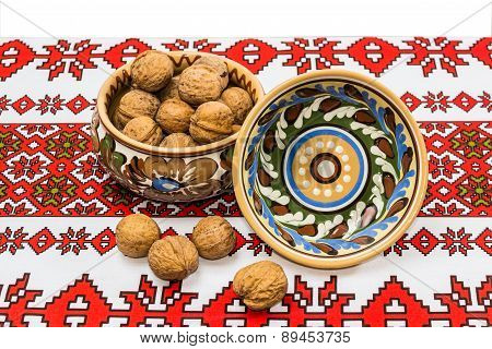 Two Bowl And Nuts On The Tablecloth