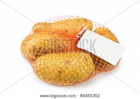 New potato in the net isolated on white ,Blank label waiting for idea.