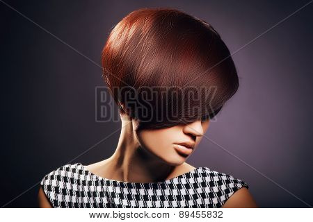 Beautiful woman portrait with fashion haircut and creative trendy make-up