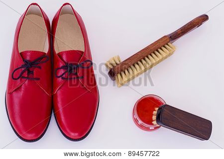 Isolated Red Shoes And Means On Care Of Footwear - Shoe-polish And Brush