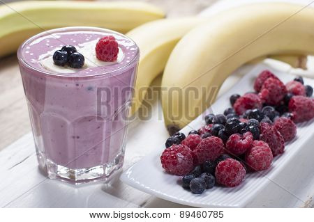 Smoothies Of Frozen Raspberries, Blueberries And Banana With Yogurt.