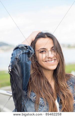 Young Brunette Woman Smiling Outdoors.