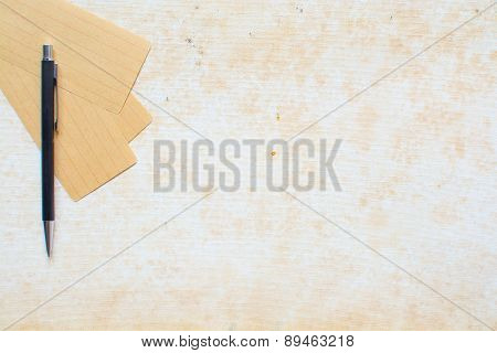 Note Paper and pen on grunge background