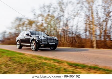 Black Car Speeding On Road