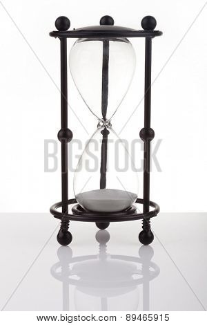 Hourglass on white background with reflection