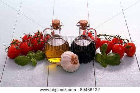 Olive Oil And Vinegar In Bottles On Wooden Table