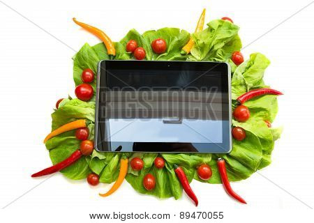 Vegetables And A Tablet Pc.