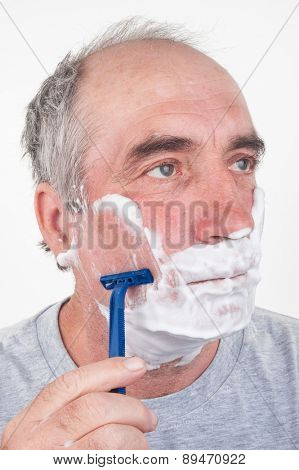 Man shaves his face