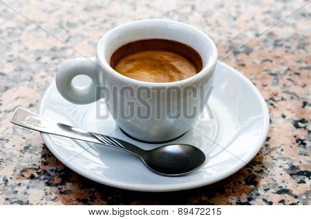 White Espresso Cup Standing On The Marble Table
