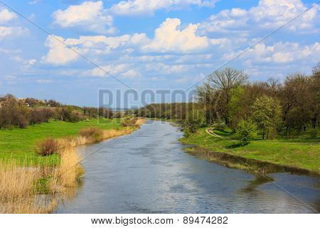spring landscape with river in forest at spring time