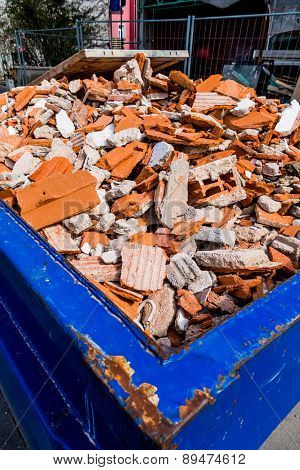 construction debris at a construction site during renovation work in a container. house is being renovated.