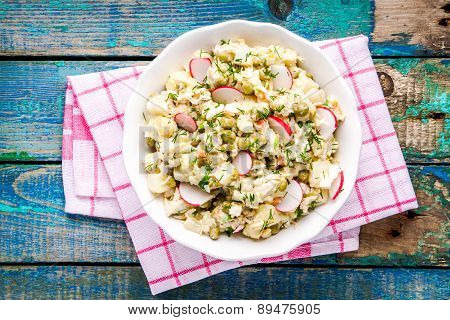 Potato Salad With Fresh Radishes In A White Bowl Top View