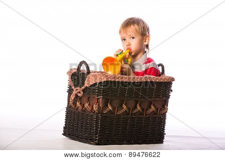 Boy In Basket With Toy