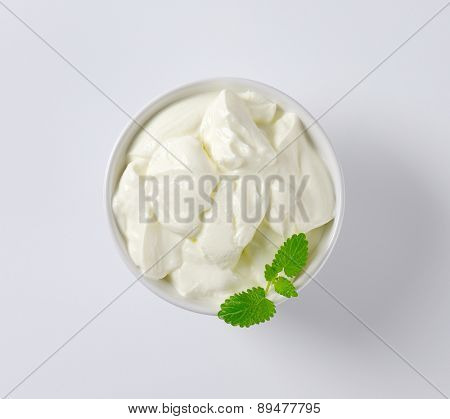 overhead view of fresh plain yogurt in the bowl