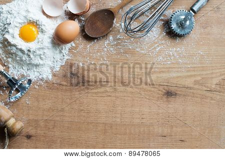Fresh ingredients and cooking utensils on rustic table