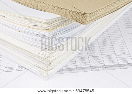 Brown Envelope And Overload Of Old Paperwork
