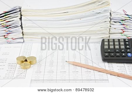 Brown Pencil And Pile Of Gold Coins With Calculator